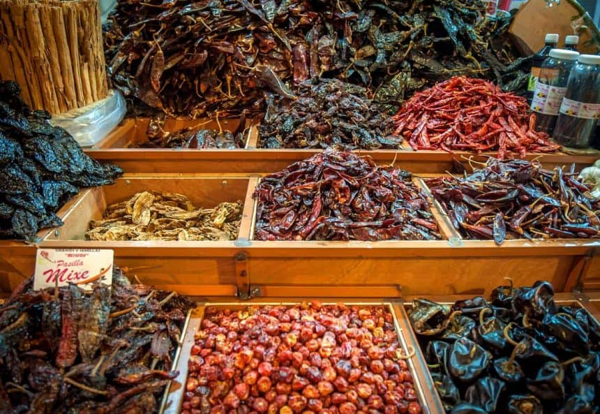 Mexican Cooking: Choice of dried chilis on a market in Oaxaca