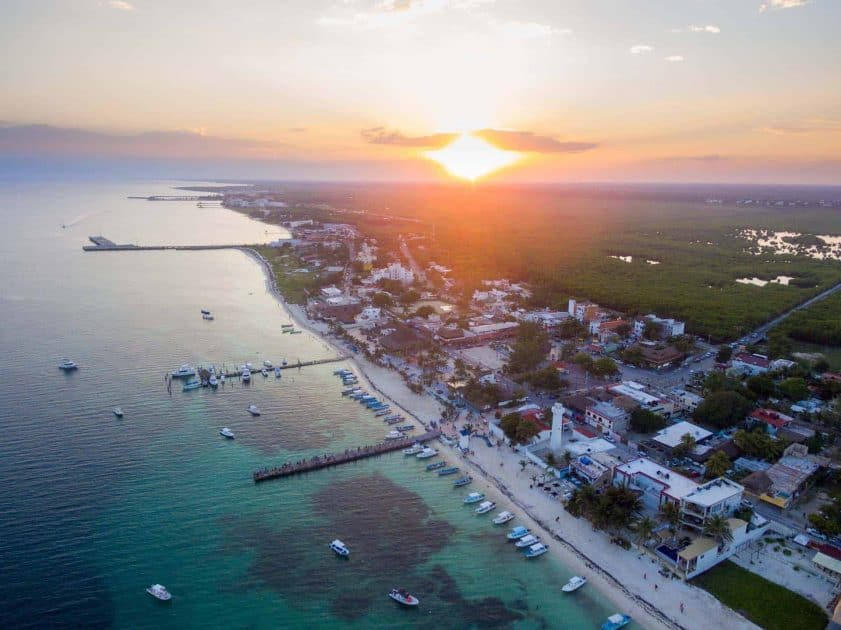 Puerto Morelos, Mexico. Travel Advisory. - Sunset over town